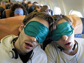 What helps you sleep on a plane